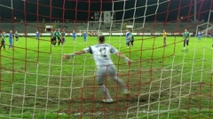 Free kick, goalie prepares for intervention, but ball went over crossbar on goal Stock Footage