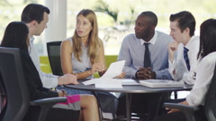 4k Attractive confident business group discuss ideas in office meeting Stock Footage