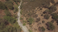 California Drought Dry Streambed Aerial Rotation HD Stock Footage