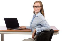 Office employee at work table with laptop isolated on white Stock Photos
