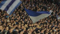 Spectators at a football match. People, crowd, football fans - stock footage