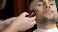 Barber shave and modeling beard at the hair salo Stock Footage