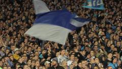 fans at a football match waving flags at the stadium. People, crowd - stock footage