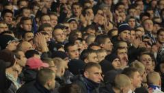 People at the stadium during the match. People, crowd, football fans - stock footage