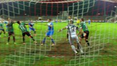 Stock Video Footage of Football-soccer,corner, chance for goal,defense players bad reaction but no goal