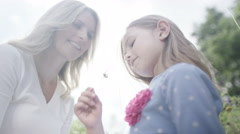 4K Happy & affectionate mother & daughter spending time together outdoors - stock footage