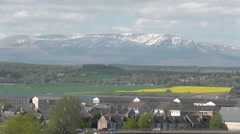 Zooming out from Ben Wyvis to Inverness cityscape Scotland Stock Footage