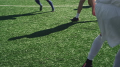 Soccer players passing the ball to each other during a game Stock Footage