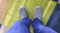 Man Taps Feet on Floor Stock Footage