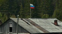 Flag of Russia on The Roof of Wooden Rural House Stock Footage