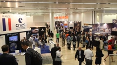 People visit the exhibition of 2015 International Astronautical Conference - stock footage