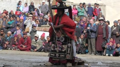SLOW MOTION Monk backbends at Festival,Lamayuru,Ladakh,India - stock footage