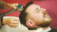 Hairdresser washes head client Stock Footage