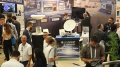 People visit the exhibition of 2015 International Astronautical Conference Stock Footage
