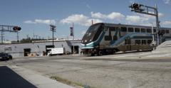 Rail Road Crossing Los Angeles Metrolink Train Crosses Intersection Stock Footage