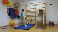 The young man is doing exercises in the gym - stock footage