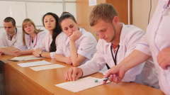 Interns in studying process (cardio snapshot reading) - stock footage