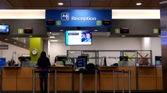 People line up for applying driver license at reception site Stock Footage
