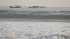 SLOW MOTION Rough surf with boats,Pangandaran,Java,Indonesia - stock footage