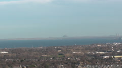 Zooming out from North Berwick Law from Edinburgh Scotland Stock Footage