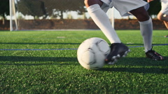 A soccer player does some fancy footwork while dribbling down the field Stock Footage