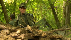 German soldier digging foxhole Stock Footage