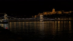 Beautiful lighted Szechenyi  Bridge and royal palace on Buda hill  by night 4 Stock Footage