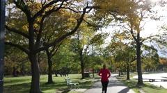 Boston Charles River Esplanade Woman Running Stock Footage