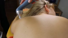 Laser therapy back of a young woman Stock Footage