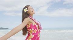 Happy serene woman relaxing on Hawaii beach enjoying freedom feeling free Stock Footage