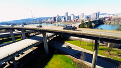 A rising aerial establishing shot of Portland Oregon bridge and city. Stock Footage