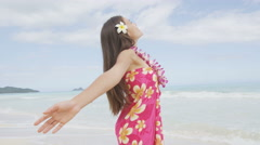Praising happy freedom woman in Hawaii beach lei and sarong Stock Footage