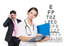 Man with glasses on eyesight test Stock Photos