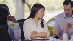 4k Attractive confident business group negotiating a deal in office meeting Stock Footage
