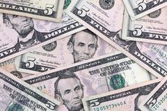 A background of crisp five dollar bills Stock Photos