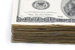 A stack of hundred dollar bills isolated on a white background - stock photo
