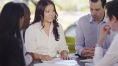4k Attractive confident business group negotiating a deal in office meeting - stock footage