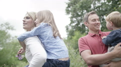4K Portrait of happy affectionate family spending time together outdoors.  - stock footage