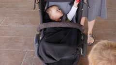 Stock Video Footage of A baby boy inside moving stroller gimbal shot
