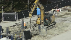 Excavator with Chains Pulling a Trench Box Stock Footage
