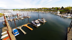 An aerial view of aport, harbor or marina with boats docked. Stock Footage