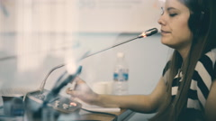 woman translator working in a conference room, working on a large business - stock footage