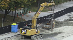 Excavator with Chains Moving a Metal Structure Stock Footage