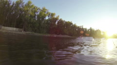 Man does extreme stunts on a wakeboard in slow motion on the lake Stock Footage