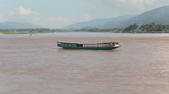 Laos transportation boats  on the Mekong river Stock Footage