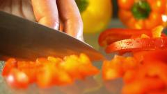 Organic Red Bell Pepper being Chopped Extreme Close Up Stock Footage