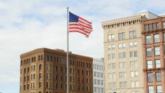 American flag and old office buildings. - stock footage