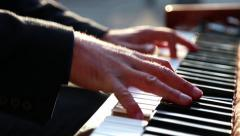 Man in the Sunset Plays Piano Stock Footage