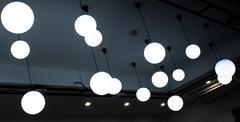 Ceiling light bulbs. - stock photo