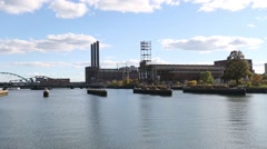 Manufacturing plants across from Providence River Stock Footage